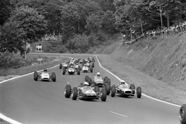 Denny Hulme, Brabham BT16 Ford, leads Frank Gardner, Lola T60 BRM, Eric Offenstadt, Cooper T75 BRM, and Graham Hill, Brabham BT16 BRM.