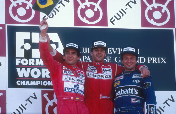 1991 Japanese Grand Prix.Suzuka, Japan.18-20 October 1991.Gerhard Berger celebrates his 1st position with teammate and newly crowned Formula One Drivers Champion Ayrton Senna, 2nd position (both McLaren Honda) and Riccardo Patrese (Williams Renault) 3rd position on the podium.Ref-91 JAP 15.World Copyright - LAT Photographic