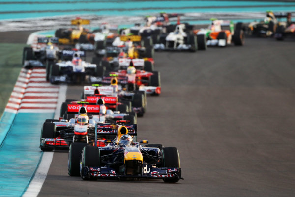 Sebastian Vettel (GER) Red Bull Racing RB6 leads at the start of the race. Formula One World Championship, Rd 19, Abu Dhabi Grand Prix, Race, Yas Marina Circuit, Abu Dhabi, UAE, Sunday 14 November 2010.  BEST IMAGE