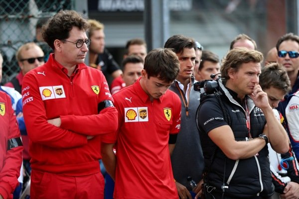 Mattia Binotto, Team Principal Ferrari, and Charles Leclerc, Ferrari, stand on the grid for the memorial of Anthoine Hubert (FRA, BWT ARDEN)