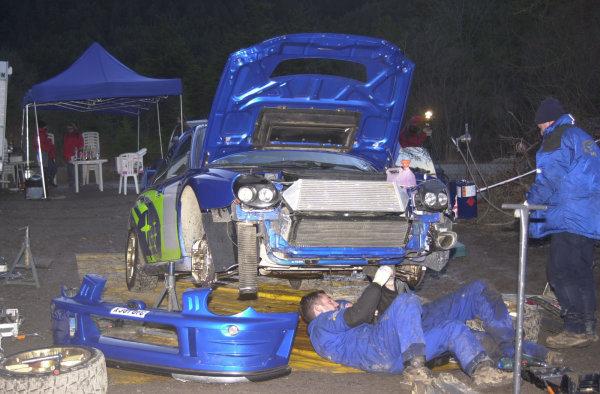 Col de Mens, France. December 18, 2000.Prodrive mechanics work on the new Subaru Impreza 44S during testing for the new season.Photo: Ralph Hardwick