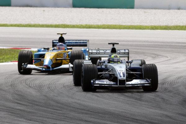 2003 Malaysian Grand Prix. Sepang, Kuala Lumpur, Malaysia.21-23 March 2003.Ralf Schumacher (Williams FW25 BMW) followed by Jarno Trulli (Renault R23).World Copyright - Steve Etherington/LAT Photographic ref: Digital Image Only