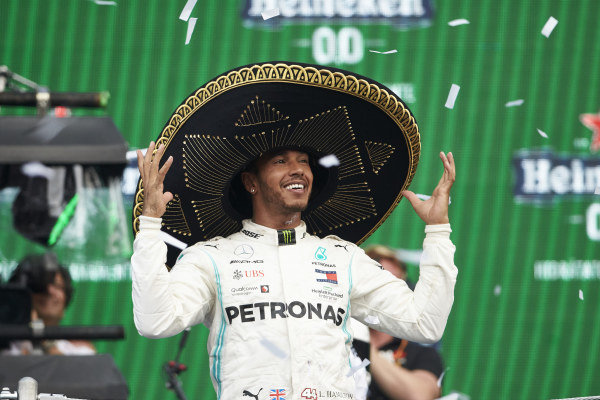 Lewis Hamilton, Mercedes AMG F1, 1st position, wears a Sombrero hat on the podium