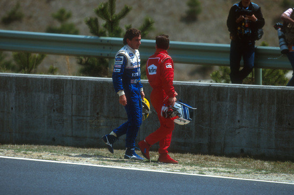 Tanaka International, Aida, Japan.15-17 April 1994.Ayrton Senna (Williams FW16 Renault) and Nicola Larini (Ferrari 412T1) walk back after ending up in the gravel together at the first corner. Senna had been helped into a spin by Hakkinen which left Larini no where to go.Ref-94 PAC 17.World Copyright - LAT Photographic