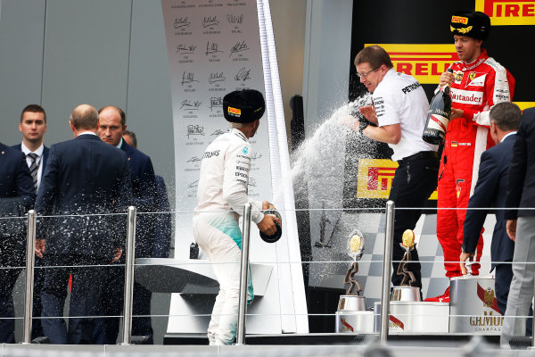 Sochi Autodrom, Sochi, Russia. Sunday 11 October 2015. Lewis Hamilton, Mercedes AMG, 1st Position, sprays Andy Cowell, Managing Director, HPP, Mercedes AMG, on the podium. World Copyright: Sam Bloxham/LAT Photographic ref: Digital Image _SBL5351