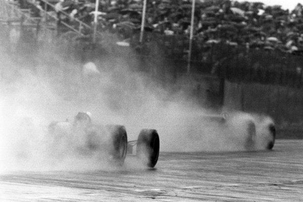 1968 Dutch Grand Prix.Zandvoort, Holland. 23 June 1968.Graham Hill, Lotus 49B-Ford, 9th position, leads Richard Attwood, BRM P126, 7th position, in the rain, action.World Copyright: LAT PhotographicRef: Motor b&w print