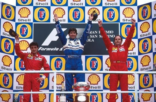Damon Hill (GBR) Williams(centre) celebrates his win with Ferrari's Jean Alesi (FRA) second (left) and Gerhard Berger (AUT) third. San Marino Grand Prix, Imola, 30 April 1995