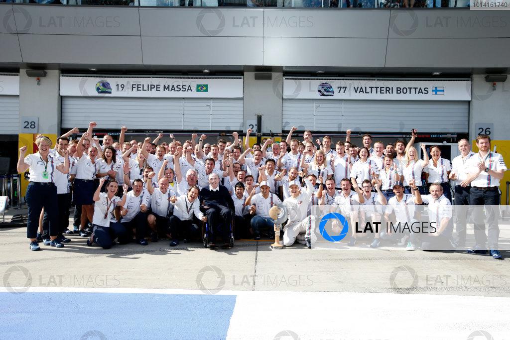 Red Bull Ring, Spielberg, Austria. Sunday 22 June 2014. The Williams team celebrate a podium finish for Valtteri Bottas, Williams F1, 3rd Position. World Copyright: Glenn Dunbar/LAT Photographic. ref: Digital Image _89P8779