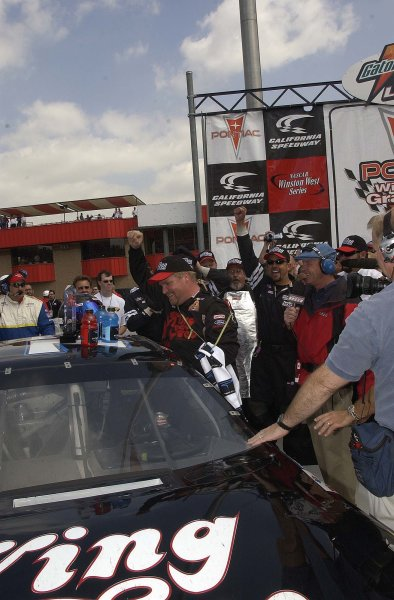 2003 NASCAR-California Speedway, April 25-27 2003 Steve Portenga getting out of his Winston West ride in victory lane,World Copyright -RobertLeSieur 2003LAT Photographic-ref: digital image