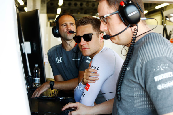 Baku City Circuit, Baku, Azerbaijan. Friday 23 June 2017. Stoffel Vandoorne, McLaren, studies data with engineers in the team's garage. World Copyright: Steven Tee/LAT Images ref: Digital Image _R3I1857