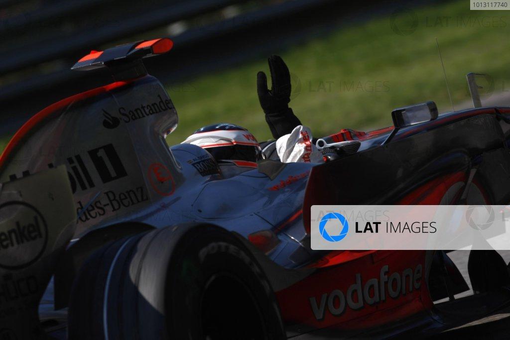 2007 Italian Grand Prix - Sunday RaceAutodromo di Monza, Monza, Italy.9th September 2007.Fernando Alonso, McLaren MP4-22 Mercedes, 1st position, celebrates on his way to Parc Ferme. Action. Finish. World Copyright: Glenn Dunbar/LAT Photographicref: Digital Image _O9T0997