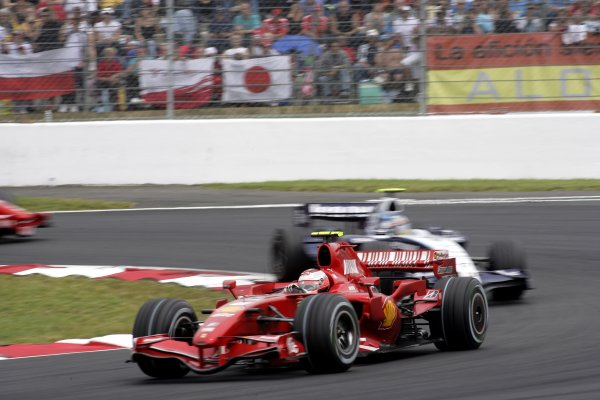 2007 French Grand Prix - Sunday RaceCircuit de Nevers Magny Cours, Nevers, France.1st July 2007.Kimi Raikkonen, Ferrari F2007, 1st position, puts a lap on Alex Wurz, Williams FW29 Toyota, 14th position. Action. World Copyright: Andrew Ferraro/LAT Photographicref: Digital Image VY9E3361