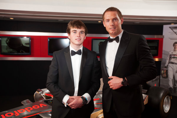 Grosvenor House Hotel, Park Lane, London 4th December 2011 McLaren Autosport BRDC Young Driver of the Year Award winner Oliver Rowland poses with the McLaren Mercedes F1 display car and a representative of TW Steel.World Copyright: Glenn Dunbar/LAT Photographic ref: Digtal Image GD5D0435