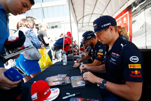 Circuit Gilles Villeneuve, Montreal, Canada. Thursday 08 June 2017. Max Verstappen, Red Bull Racing, signs autographs for fans alongside Daniel Ricciardo, Red Bull Racing.  World Copyright: Andy Hone/LAT Images ref: Digital Image _ONZ9856