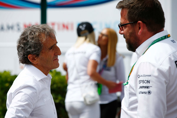 Red Bull Ring, Spielberg, Austria. Sunday 09 July 2017. Alain Prost talk to Gwen Lagrue of Mercedes. World Copyright: Andy Hone/LAT Images ref: Digital Image _ONZ1180