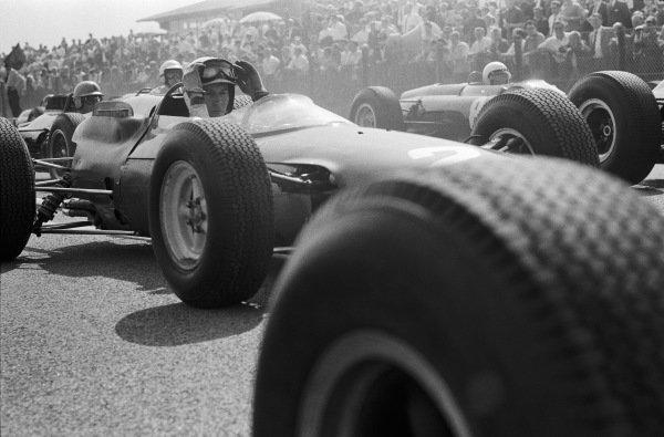 John Surtees, Ferrari 158, prepares for the start.