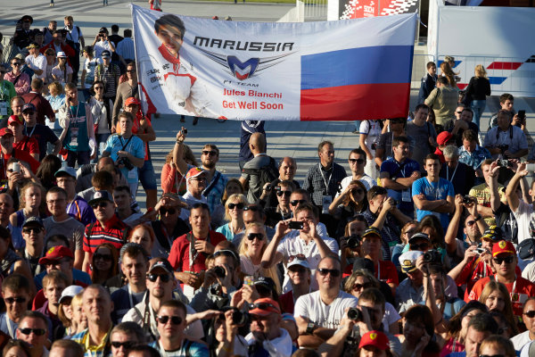 Sochi Autodrom, Sochi, Russia. Thursday 9 October 2014. Fans hold up a banner with a message of support for Jules Bianchi, Marussia F1. World Copyright: Steve Etherington/LAT Photographic. ref: Digital Image SNE14379