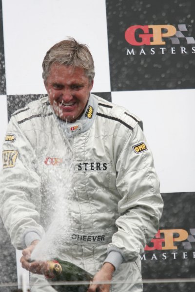 2006 Grand Prix Masters.Silverstone, England. 11th - 13th August.Eddie Cheever celebrates victory on the podium.Portrait.World Copyright: Drew Gibson/LAT Photographic.Ref: Digital Image Only.