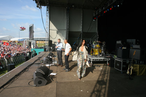 Silverstone, Northamptonshire, England21st June 2009Lewis Hamilton, McLaren MP4-24 Mercedes on stage with girlfriend Nicole Scherzinger of the Pussycat Dolls at the party.World Copyright: Jakob Ebrey/LAT Photographicref: Digital Image JE__2121