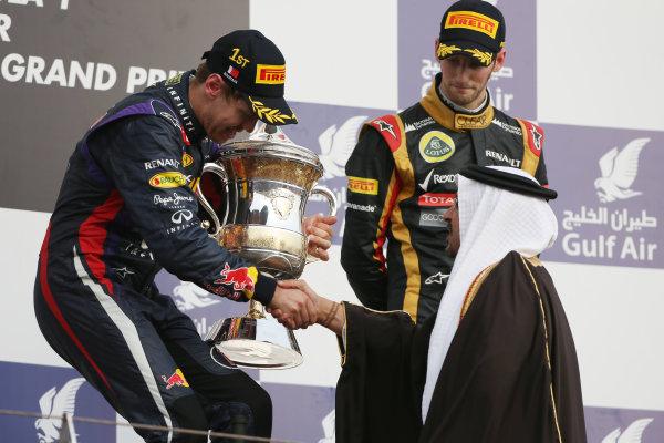 Bahrain International Circuit, Sakhir, Bahrain Sunday 21st April 2013 Sebastian Vettel, Red Bull Racing, 1st position, receives his winners trophy on the podium. World Copyright: Andy Hone/LAT Photographic ref: Digital Image HONZ2996