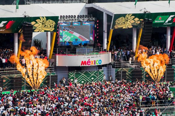 Autodromo Hermanos Rodriguez, Mexico City, Mexico. Sunday 29 October 2017. The background revolves to reveal top DJ, Hardwell, on the podium behind Max Verstappen, Red Bull, 1st Position, Valtteri Bottas, Mercedes AMG, 2nd Position, andKimi Raikkonen, Ferrari, 3rd Position. World Copyright: Zak Mauger/LAT Images  ref: Digital Image _31I8096
