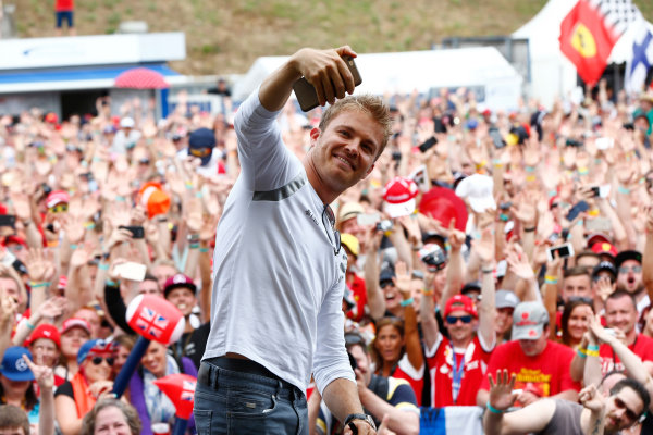 Hockenheim, Germany. Saturday 30 July 2016. Nico Rosberg, Mercedes AMG, takes a photo in front of an enthusiastic crowd. World Copyright: Andy Hone/LAT Photographic ref: Digital Image _ONY7776