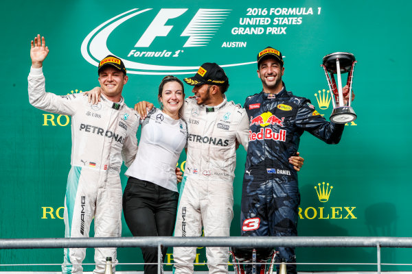Circuit of the Americas, Austin Texas, USA. Sunday 23 October 2016. Nico Rosberg, Mercedes AMG, 2nd Position, Victoria Vowles, Partner Services Director, Mercedes AMG, Lewis Hamilton, Mercedes AMG, 1st Position, and Daniel Ricciardo, Red Bull Racing, 3rd Position, on the podium. World Copyright: Glenn Dunbar/LAT Photographic ref: Digital Image _31I5274