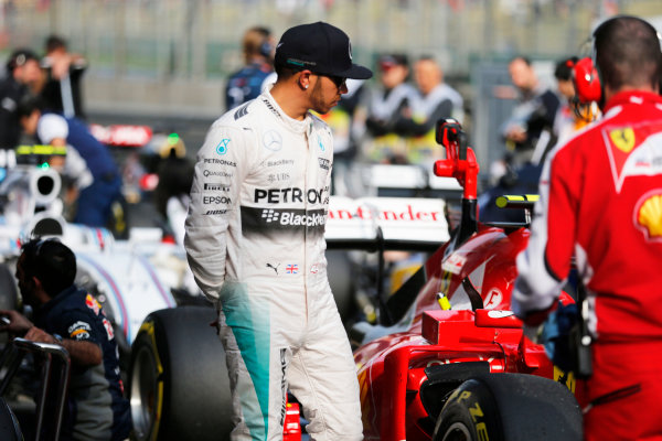 Shanghai International Circuit, Shanghai, China. Saturday 11 April 2015. Pole man Lewis Hamilton, Mercedes AMG, inspects the rival Ferrari in Parc Ferme. World Copyright: Steven Tee/LAT Photographic. ref: Digital Image _L4R7641