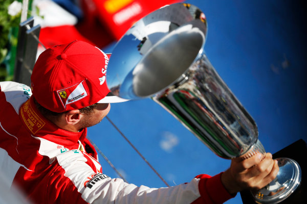 Hungaroring, Budapest, Hungary. Sunday 26 July 2015. Sebastian Vettel, Ferrari, 1st Position, with his trophy. World Copyright: Alastair Staley/LAT Photographic ref: Digital Image _79P1010