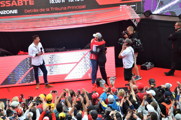 Will Buxton (GBR) FOM TV Presenter with Fernando Alonso (ESP) McLaren and Marc Gene (ESP) Ferrari on the Fanzone stage