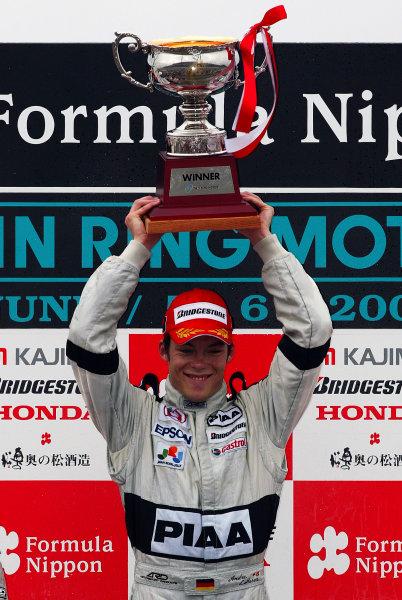 2004 Formula Nippon ChampionshipMotegi, Japan. 6th June 2004.Race winner, Andre Lotterer (PIAA Nakajima), podium.World Copyright: Yasushi Ishihara/LAT Photographicref: Digital Image Only