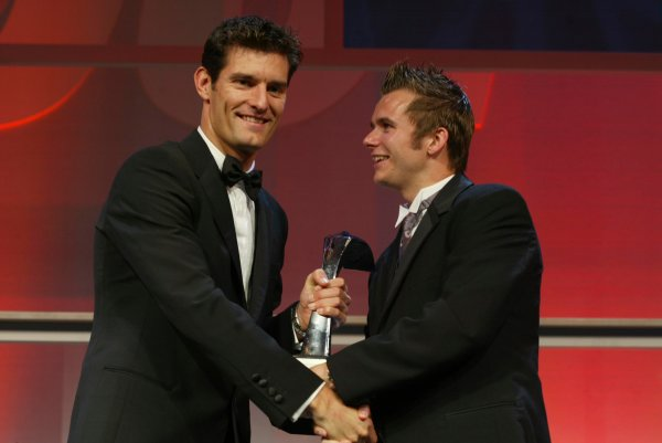 2003 AUTOSPORT AWARDS, The Grosvenor, London. 7th December 2003.Dan Wheldon accepts the award for Rookie of the year from Mark Webber.Photo: Peter Spinney/LAT PhotographicRef: Digital Image only
