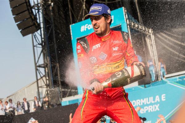 Mexico City e-Prix, Mexico, Central America. Sunday 13 March 2016 Lucas Di Grassi (BRA), ABT Audi Sport FE01 sprays champagne on the podium. Photo: Andrew Ferraro/LAT/FE ref: Digital Image _FER6624