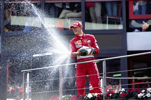 Michael Schumacher, 2nd position, celebrates his 7th World Championship on the podium.