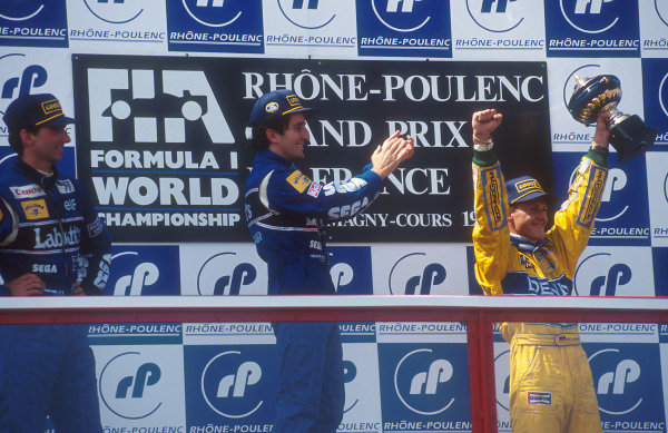 1993 French Grand Prix.Magny-Cours, France.2-4 July 1993.Alain Prost (Williams Renault) 1st position, Damon Hill (Williams Renault) 2nd position and Michael Schumacher (Benetton Ford) 3rd position on the podium.  Ref: 93FRA11. World Copyright - LAT Photographic