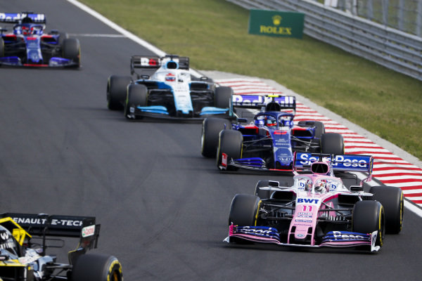 Sergio Perez, Racing Point RP19, leads Alexander Albon, Toro Rosso STR14, and George Russell, Williams Racing FW42