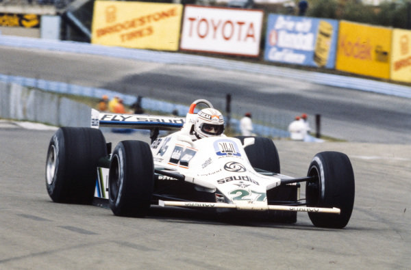Alan Jones, Williams FW07B Ford, through the Esses.