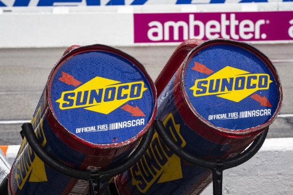 Sunoco fuel cans in the rain