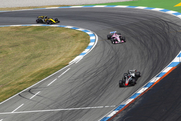 Romain Grosjean, Haas F1 Team VF-18 Ferrari, leads Sergio Perez, Force India VJM11 Mercedes, and Carlos Sainz Jr., Renault Sport F1 Team R.S. 18.