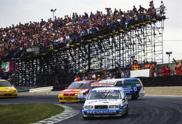 Jan Lammers, Volvo 850 Racing, Volvo 850 SE/GLT, leads as Patrick Watts, Peugeot Sport, Peugeot 405 Mi16, and Rickard Rydell, Volvo 850 Racing, Volvo 850 SE/GLT, clash in the background.