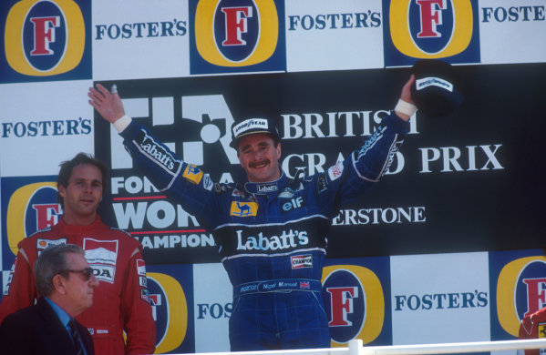 1991 British Grand Prix. Silverstone, England. 12-14 July 1991. Nigel Mansell (Williams Renault) celebrates 1st position on the podium, with Gerhard Berger (McLaren Honda) 2nd position. FIA President Jean-Marie Balestre stands in front. Ref-91 GB 06. World Copyright - LAT Photographic