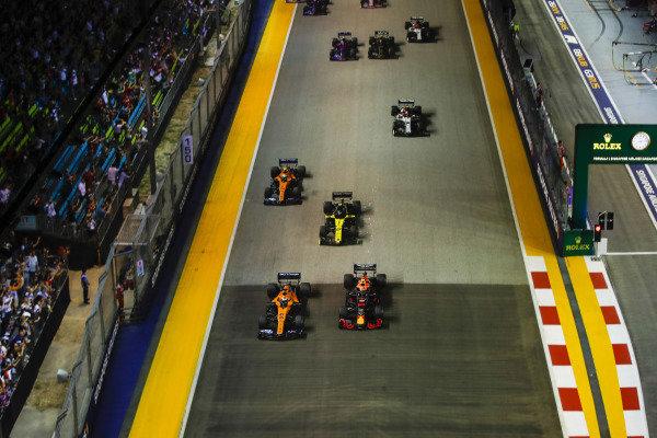 Carlos Sainz Jr., McLaren MCL34, leads Alexander Albon, Red Bull RB15, Nico Hulkenberg, Renault R.S. 19, and Lando Norris, McLaren MCL34