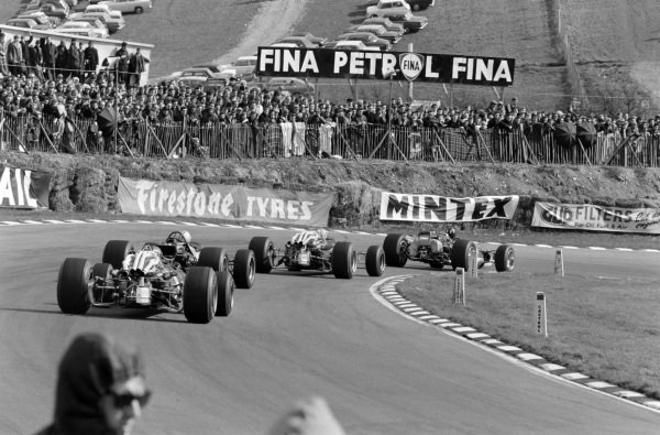 Graham Hill, Lotus 49 Ford, retired, leads Jacky Ickx, Ferrari 312, 8th position, Denny Hulme, McLaren M7A Ford, 3rd position, and Chris Amon, Ferrari 312, 4th position.