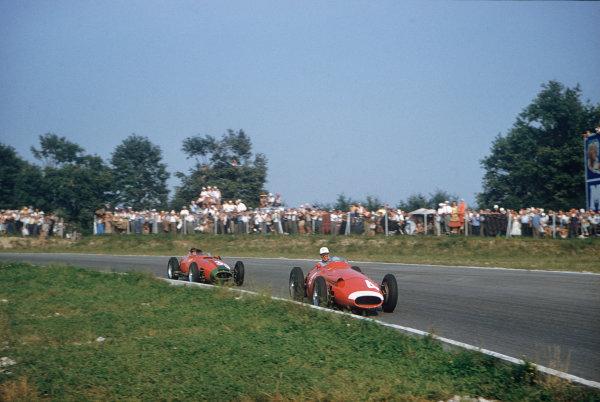Monza, Italy. 6-8 September 1957. Harry Schell (Maserati 250F) leads Peter Collins (Lancia-Ferrari 801). Ref: 57ITA31. World Copyright - LAT Photographic
